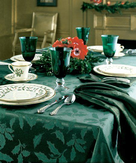 This tablecloth's holly motif and vibrant red hue set the